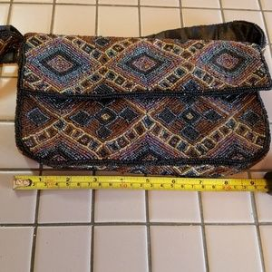 Vintage multi colored beaded wristlet style purse.